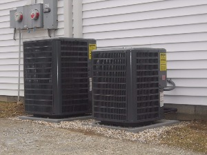Two air conditioning units outside a home.